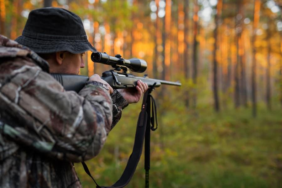 Hunter aiming with rifle
