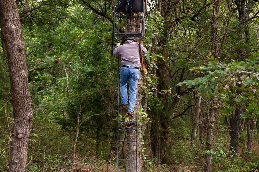 hunter descending from a ladder stand